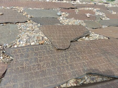Large stones with ancient writings in Ladakh, India.