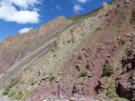 Multicolored rocks in the mountains of Ladakh in India.