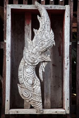 Thai naga carving photo