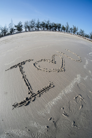 Drawings on sea sand photo