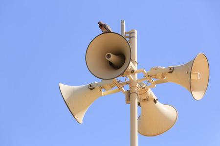 Megaphones and bird photo