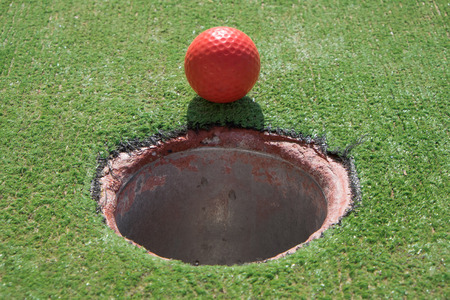 Red golf ball photo