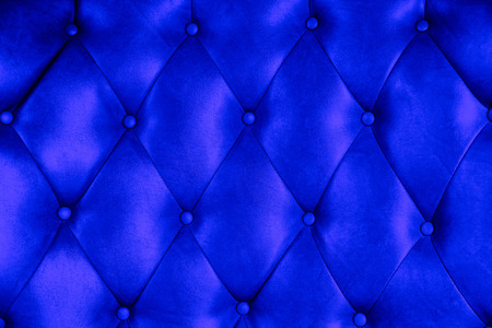Luxury upholstery leather button chair texture in blue photo
