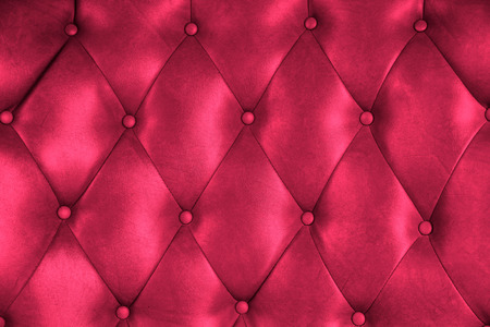 Luxury upholstery leather button chair texture in magenta photo