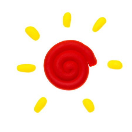 Sun modelling clay isolated on white