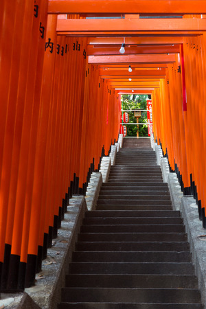 signify: TOKYO - CIRCA APRIL, 2014: In Shinto torii gates signify entrance to pure land of shrines on CIRCA April, 2014