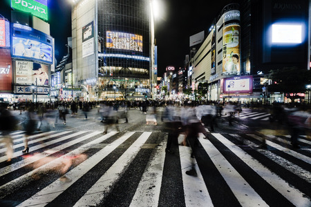 SHIBUYA, TOKYO-CIRCA JUNE 2014: Shibuya scrambled crossing is one of the busiest of the world on circa June 2014