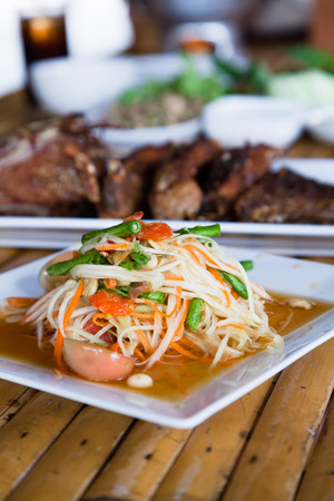 Thai hot and spicy papaya salad photo