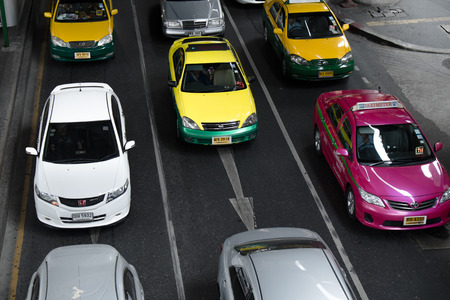 BANGKOK, THAILAND - 14 FEBURARY 2014: Taxis make up more than half of vehicles on the road in Bangkok. It is the major cause of traffic jam.
