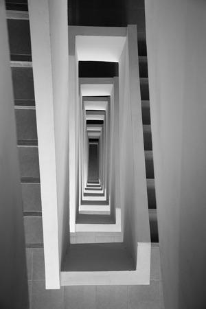 Looking down stairway rectangular spiral photo