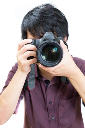 Asian man taking a picture with dslr camera photo