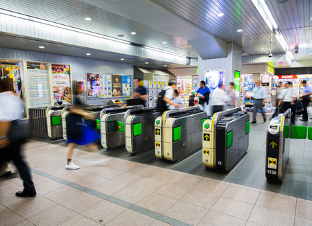 TOKYO, JAPAN-CIRCA JULY, 2014:People passing the gate. Commutor trains are the main mode of transportation in Tokyo.