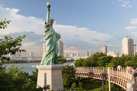 exists: ODAIBA,TOKYO-CIRCA JUNE 2014: There exists a replica of statue of liberty in odaiba, japan on CIRCA June 2014 Editorial