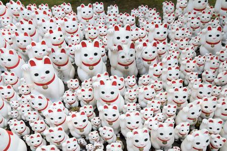 maneki neko: Maneki neko also known as chinese fortune cat Stock Photo