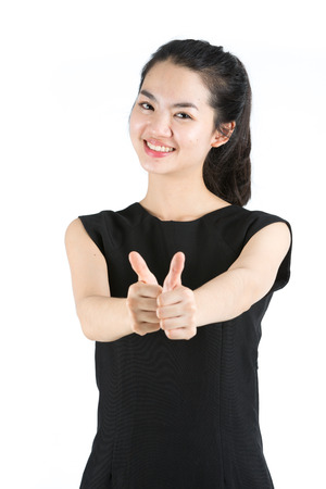 Young asian woman giving thumbs up photo