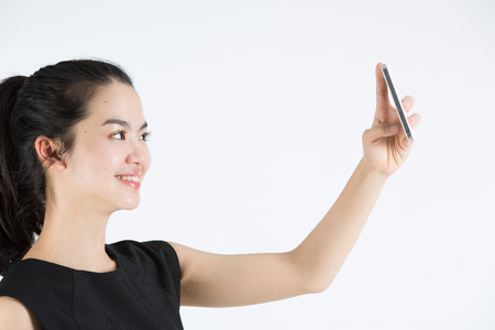 Young asian lady taking a selfie photo