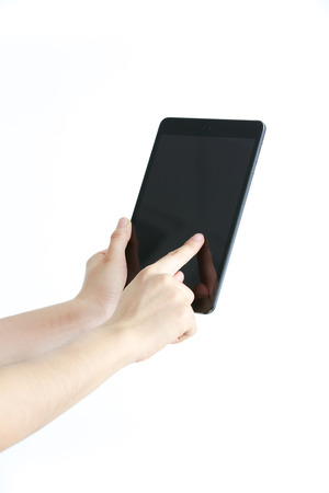 Woman hand using a tablet photo
