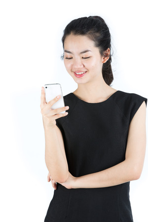 Asian lady using a mobilephone photo