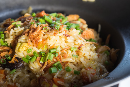 Thai crab fried rice on white dish with cucumbers photo