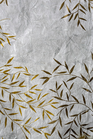 Mulberry paper texture with golden and silver leaf photo
