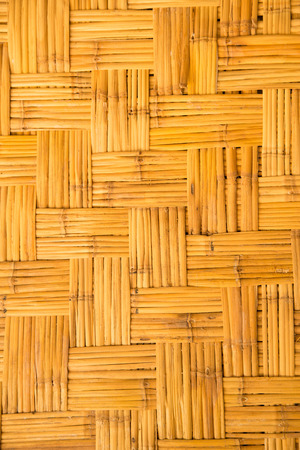 weaved: yellow  weaved traiditional bamboo wicker background Stock Photo