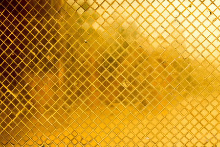 golden light: texture of golden mosaic from a thai temple