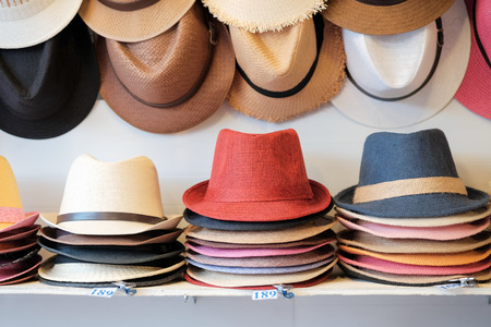 Starw hats for sale, hanging on a wall