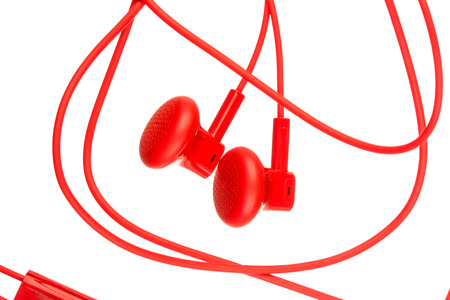 earbuds: Close up on red earbuds isolated on white background