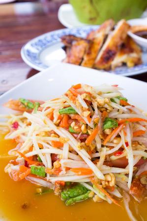 somtum: Somtum or Thai spicy papaya salad - Selective focus Stock Photo