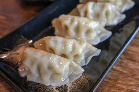 potstickers: Japanese styled gyoza. Gyoza is originated from China. - Selective focus