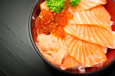 Salmon Chirashi or shake  sake served with preserved ginger - Selective focus