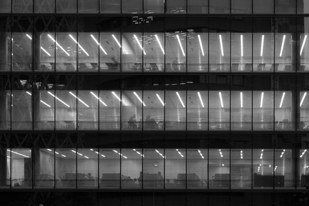 office time: Office workers working late - Black and White Stock Photo