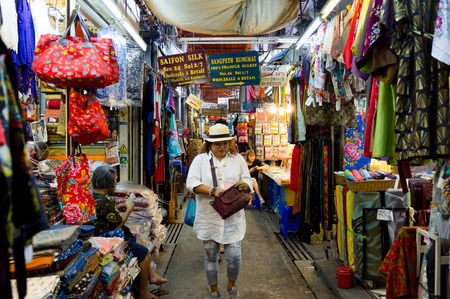 BANGKOK, THAILAND - CIRCA JULY 2015: Clothes for sale at Chatuchak weekend market. It is one of the largest market in Asia.