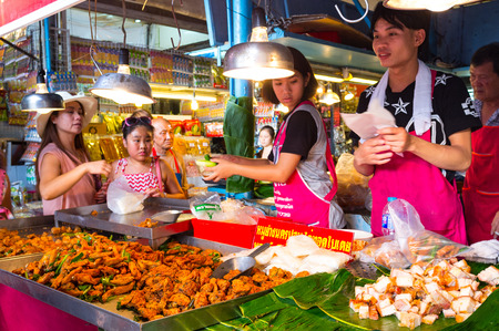 BANGKOK, THAILAND - CIRCA JULY, 2015: Street food for sale at Chatuchak weekend market. It is one of the largest market in Asia.