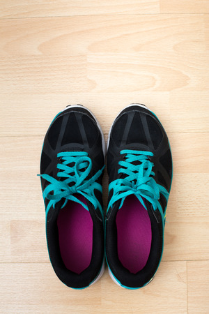 Sports shoes on wooden surface - Studio shot