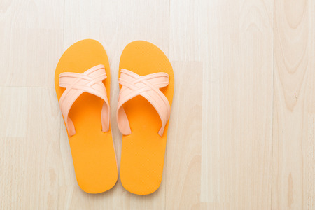 flip flops: A pair of flip flops on wooden surface background