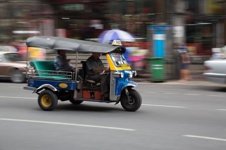 tuk: BANGKOK, THAILAND - CIRCA JULY, 2015: Unidentified tuk tuk driver speeding in China town, Bangkok. Editorial