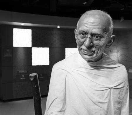 mahatma: BANGKOK, THAILAND - CIRCA August, 2015: Wax figure of the famous Mahatma Ghandi from Madame Tussauds, Siam Discovery, Bangkok