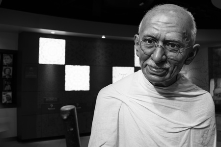 nonviolence: BANGKOK, THAILAND - CIRCA August, 2015: Wax figure of the famous Mahatma Ghandi from Madame Tussauds, Siam Discovery, Bangkok