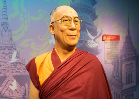 holiness: BANGKOK, THAILAND - CIRCA August, 2015: Wax figure of the famous Dalai Lama from Madame Tussauds, Siam Discovery, Bangkok