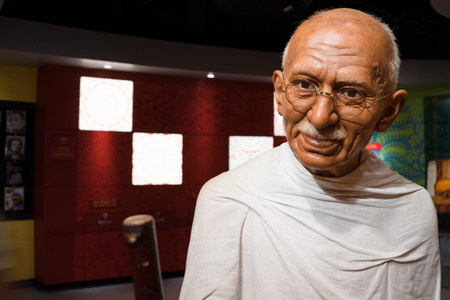 famous people: BANGKOK, THAILAND - CIRCA August, 2015: Wax figure of the famous Mahatma Ghandi from Madame Tussauds, Siam Discovery, Bangkok
