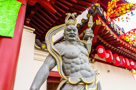 september 9th: singapore - September 9th, 2015: A giant guards front gate of the Buddha Tooth Relic Temple, Singapore. Editorial
