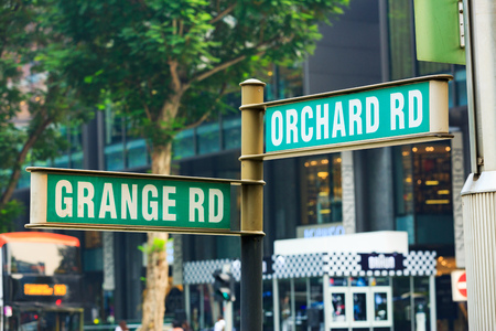 singapore - September 15th, 2015: Orchard road street sign in shopping area, Singapore. Редакционное