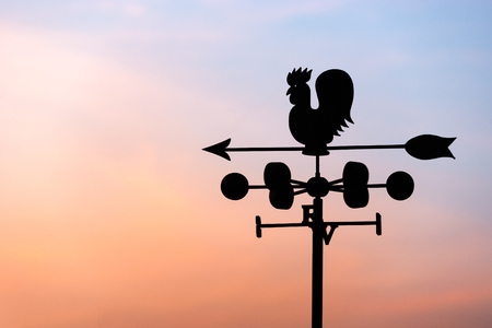 rooster at dawn: Chicken wind vane with compass and sky
