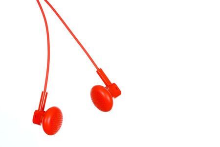 ear buds: Red ear buds isolated on white bacnground