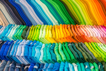 sale shop: Lines of colorful clothing from clothes store Stock Photo