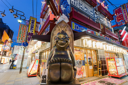 city fish market sign: OSAKA, JAPAN - 26 APRIL 2016: Statue of the Billiken on Shinsekai street. Billiken is originated from America, created by Florence Pretz.