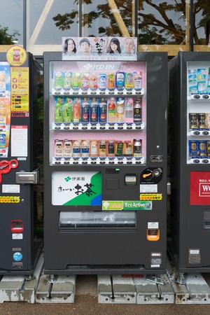 capita: OSAKA, JAPAN - CIRCA APRIL, 2016: Vending machines of various company in Osaka. Japan has the highest number of vending machine per capita in the world at about one to twenty three people.