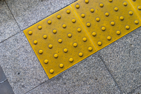truncated: Warning textile for the disabled from a train station