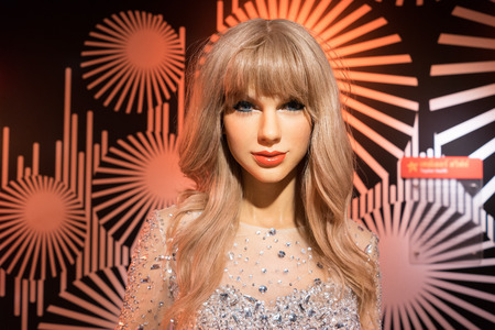 swift: BANGKOK, THAILAND - CIRCA August, 2015: Wax figure of the famous Taylor Swift from Madame Tussauds, Siam Discovery, Bangkok